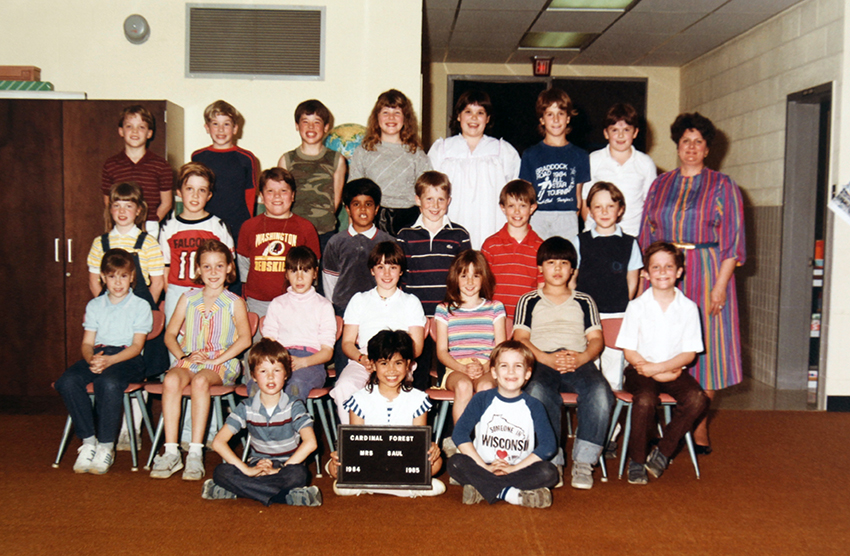 Cardinal Forest class photograph taken during the 1984 to 1985 school year. 24 students and their teacher are pictured.