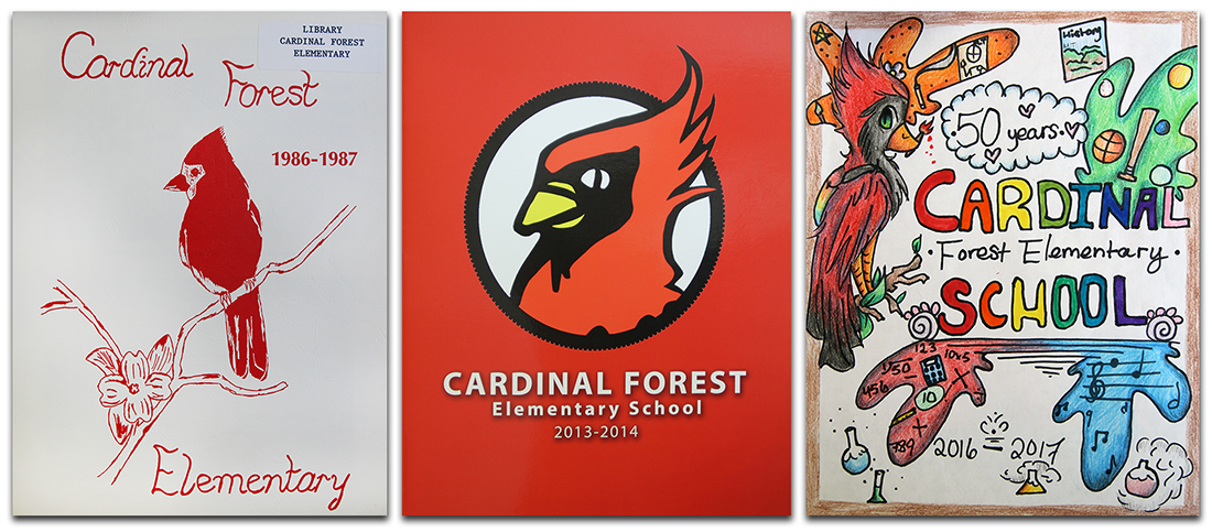Photographs of the covers of three Cardinal Forest yearbooks. They are, left to right, 1987, 2014, 2017.